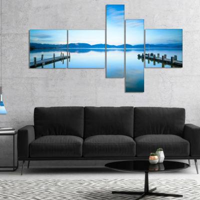 Designart Two Wooden Piers In Blue Sea MultipanelSeascape Canvas Art Print - 4 Panels