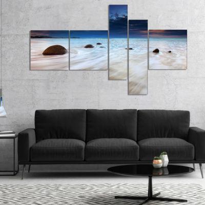 Designart Waves Flowing Over Boulders MultipanelSeashore Photo Canvas Art Print - 4 Panels