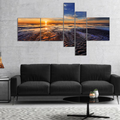 Designart Waves On The Sand During Sunset Multipanel Seashore Canvas Art Print - 5 Panels