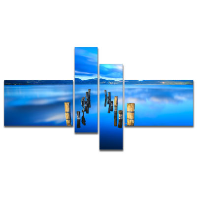 Designart Wooden Pier Remains In Blue Sea Multipanel Seascape Canvas Art Print - 4 Panels
