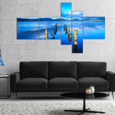 Designart Wooden Pier Remains In Blue Sea Multipanel Seascape Canvas Art Print - 5 Panels
