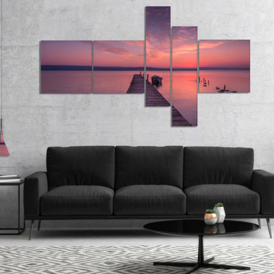 Designart Wooden Pier Under Red Sky Multipanel Seascape Canvas Art Print - 5 Panels