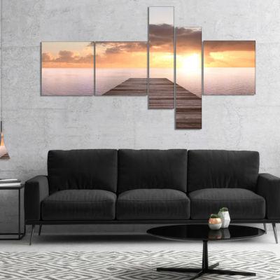 Designart Yellow Sea And Brown Pier Multipanel Seascape Canvas Art Print - 5 Panels