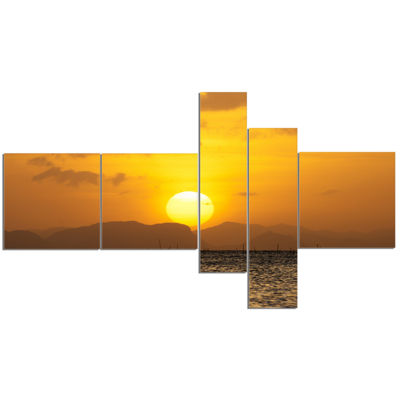 Designart Yellow Sunset And Brown Ocean MultipanelSeashore Canvas Art Print - 5 Panels