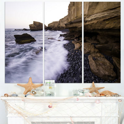 Designart Rolling Stones At Beach Seashore PhotoCanvas Art Print - 3 Panels