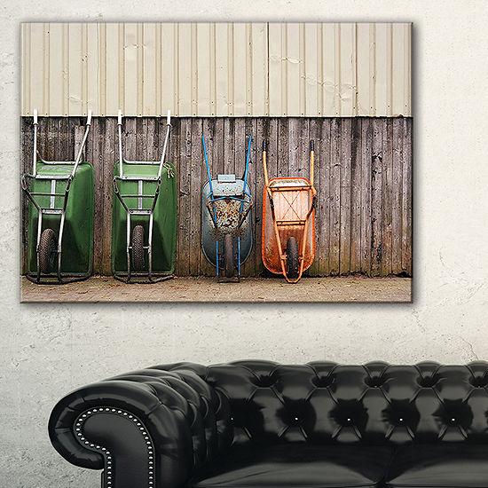 Designart Row Of Wheelbarrows Landscape Photo Canvas Art Print - 3 Panels
