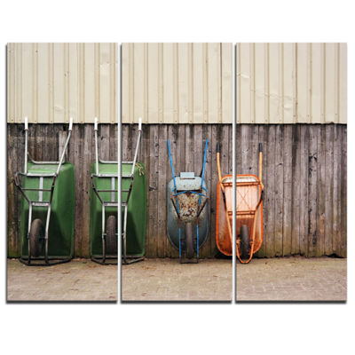 Designart Row Of Wheelbarrows Landscape Photo Canvas Art Print - 3 Panels