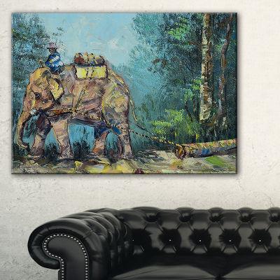 Designart Elephant Dragging Logs Animal Art CanvasPrint