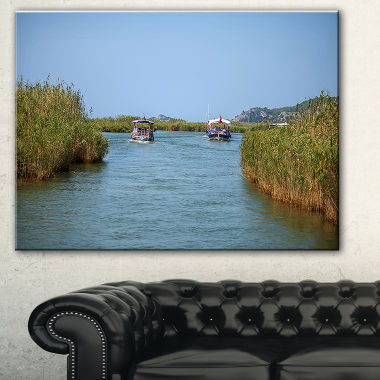 Designart Touristic River Boats Landscape Photography Canvas Art Print