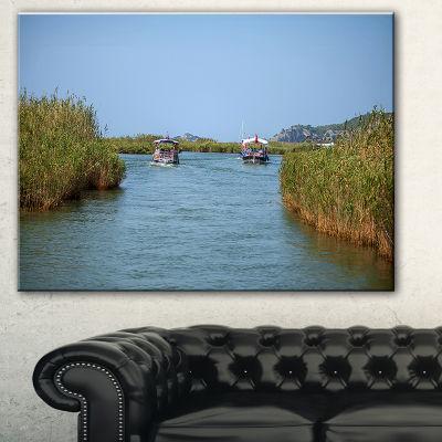 Designart Touristic River Boats Landscape Photography Canvas Art Print