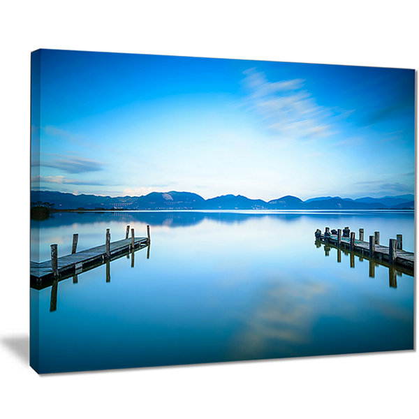 Designart Two Wooden Piers In Blue Sea Seascape Canvas Art Print