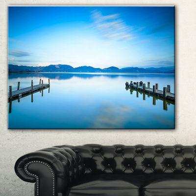 Designart Two Wooden Piers In Blue Sea Seascape Canvas Art Print - 3 Panels
