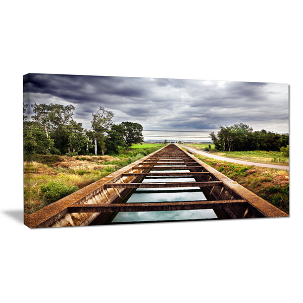 Designart Water Channel And Trees Landscape PhotoCanvas Art Print