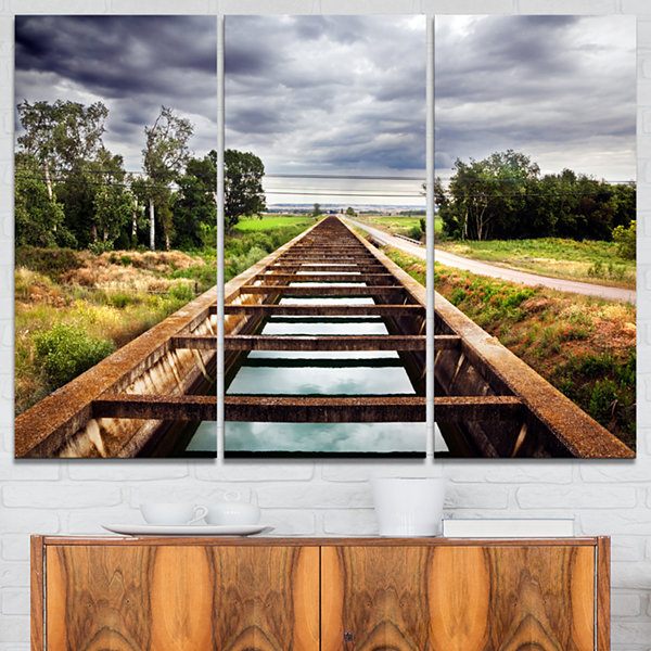 Designart Water Channel And Trees Landscape PhotoCanvas Art Print - 3 Panels