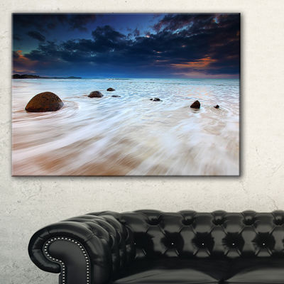 Designart Waves Flowing Over Boulders Seashore Photo Canvas Art Print - 3 Panels