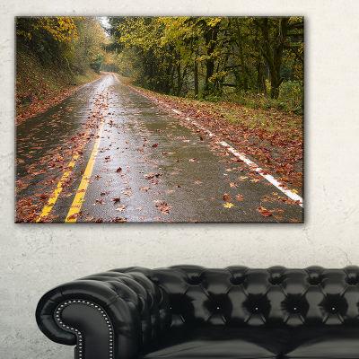 Designart Wet Rainy Road In Forest Landscape PhotoCanvas Art Print