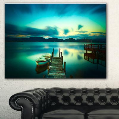 Designart Wooden Jetty And Boat In Sea Seascape Canvas Art Print