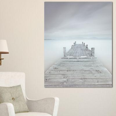 Designart Wooden Pier In Cloudy Mood Seascape Canvas Art Print