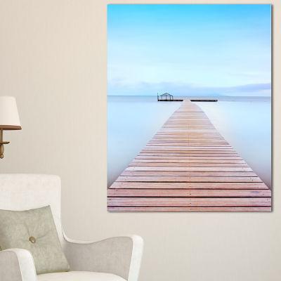 Designart Wooden Pier In Cold Atmosphere SeascapeCanvas Art Print - 3 Panels