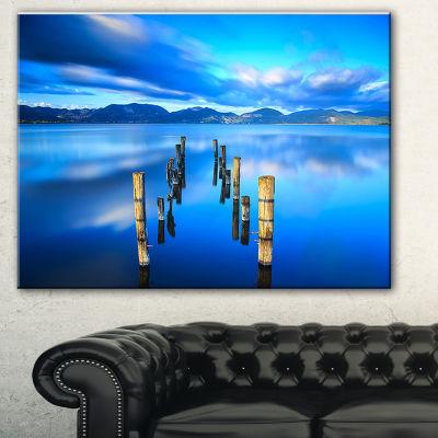 Designart Wooden Pier Remains In Blue Sea SeascapeCanvas Art Print