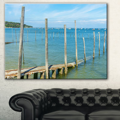 Designart Wooden Piers By Blue Sea Seascape CanvasArt Print
