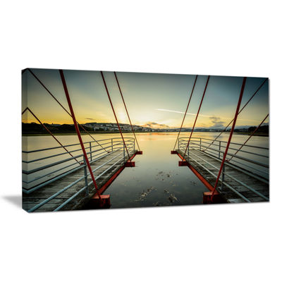 Designart Wooden Piers For Boats In Spain SeashorePhoto Canvas Print