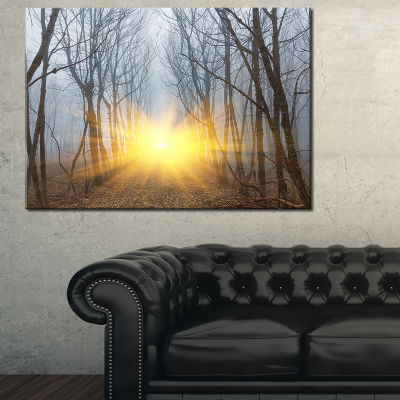 Designart Yellow Sun Rays In Misty Forest Landscape Photography Canvas Print