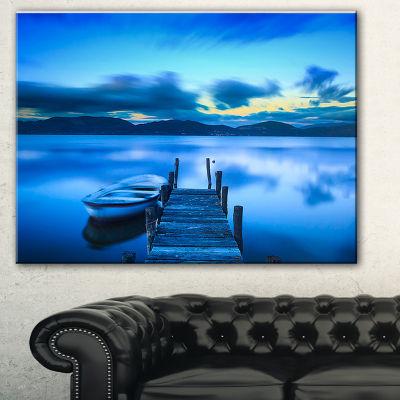 Designart Cloudy Blue Sky With Pier Seascape Canvas Art Print