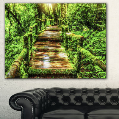 Designart Moss Around Wooden Walkway In Rain Photography Canvas Art Print