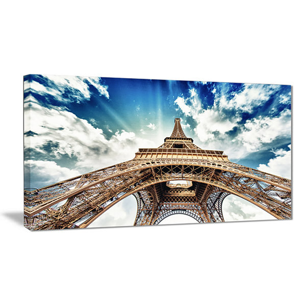 Designart Paris Eiffel Towerwith Fast Moving Clouds Photography Canvas Art Print