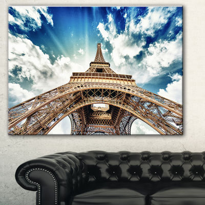 Designart Paris Eiffel Towerwith Fast Moving Clouds Photography Canvas Art Print - 3 Panels