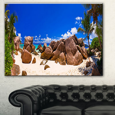 Designart Rocky Tropical Beach Panorama LandscapePhotography Canvas Print - 3 Panels