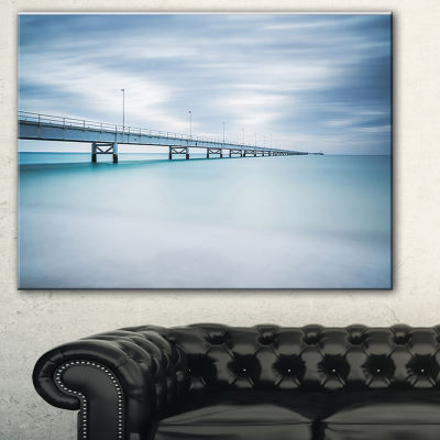 Designart Industrial Pier Side View Seascape Canvas Art Print