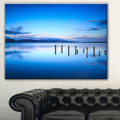 Designart Jetty Remains In Blue Sea Seascape Canvas Art Print - 3 Panels