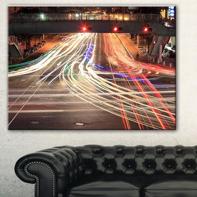 Designart Light Traces On Crossroad Cityscape Digital Art Canvas Print