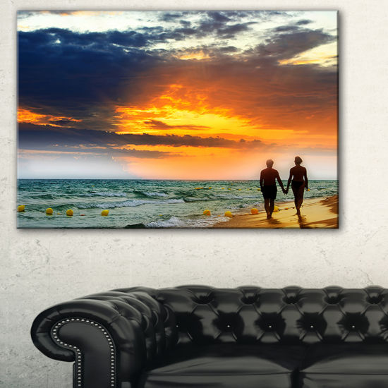 Designart Lovers At Beach Seashore Photography Canvas Art Print