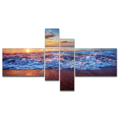 Designart Blue Sea Waves During Sunset MultipanelSeashore Canvas Art Print - 4 Panels