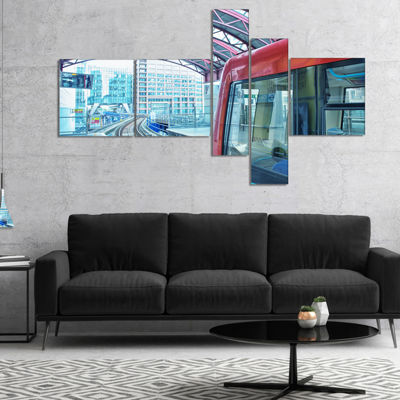 Designart Departing London Subway Train MultipanelModern Cityscape Canvas Art Print - 5 Panels