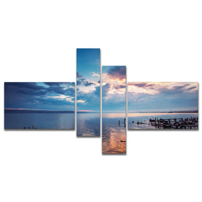 Designart Dramatic Sky Over Sunset Lake MultipanelLarge Landscape Canvas Art - 4 Panels