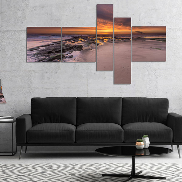Designart Dramatic Sunrise Over Sandy Beach Multipanel Seashore Canvas Art Print - 4 Panels