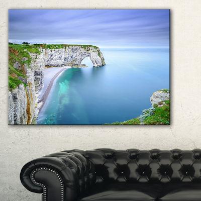 Designart Manneporte Natural Rock Arch Seashore Photo Canvas Print - 3 Panels