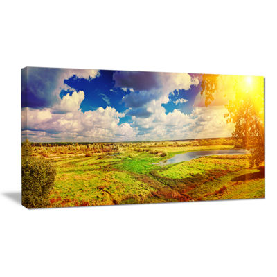 Designart Meadow With Small Flood Sky Landscape Photography Canvas Print