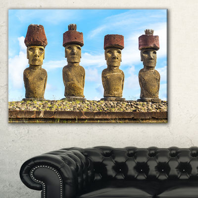 Designart Moai With Red Topknot Hat Portrait PhotoCanvas Art Print