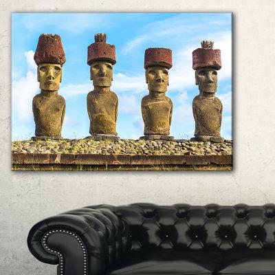 Designart Moai With Red Topknot Hat Portrait PhotoCanvas Art Print - 3 Panels