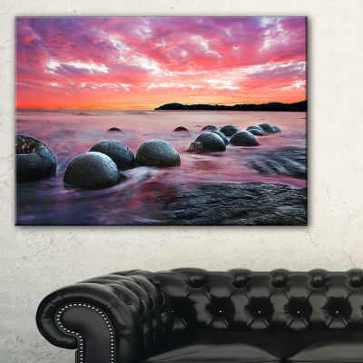 Designart Moeraki Boulders At Sunset Seashore Photo Canvas Art Print - 3 Panels