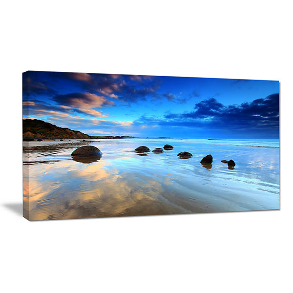 Designart Moeraki Boulders Under Cloudy Sky Seashore Photo Canvas Print