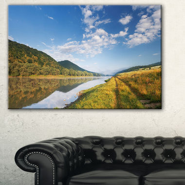 Designart Mountain River Under Blue Sky LandscapePhotography Canvas Print
