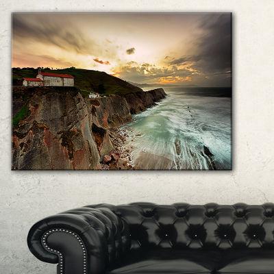 Designart Ocean Hitting Rocky Hill Seashore PhotoCanvas Art Print