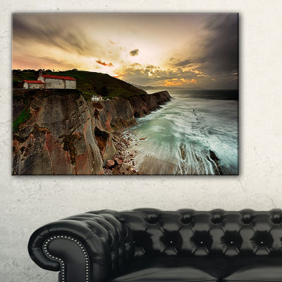Designart Ocean Hitting Rocky Hill Seashore PhotoCanvas Art Print - 3 Panels