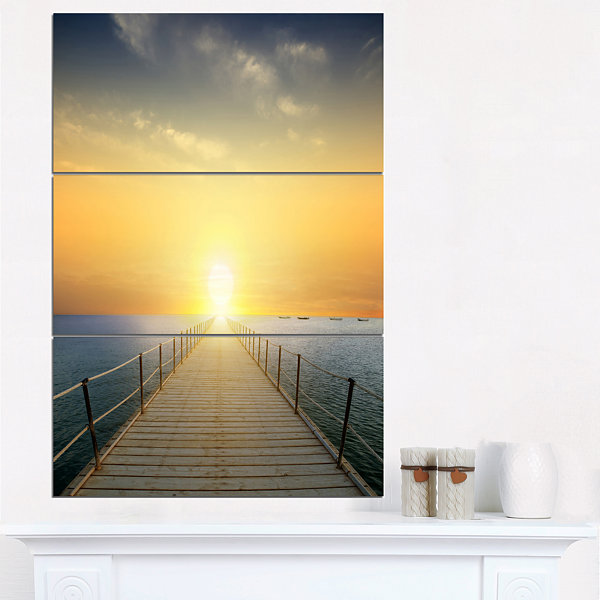 Designart Ocean Sunset With Pier Seascape CanvasArt Print - 3 Panels